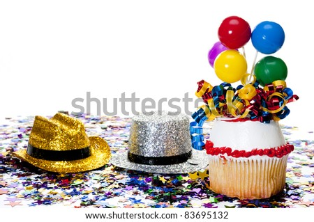 Cupcake, Hats, and Confetti at Party