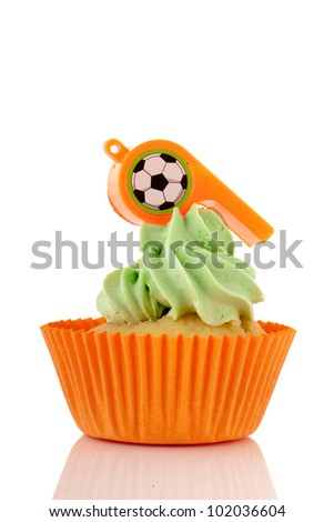 Cupcake in orange and green isolated over white background
