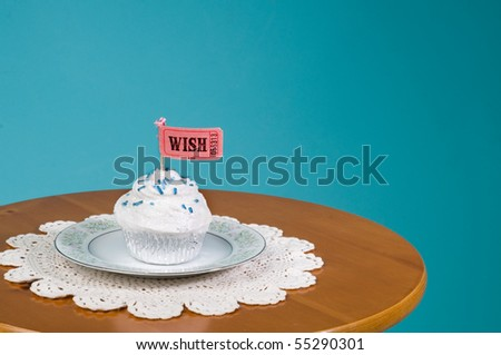 cupcake on saucer and doily