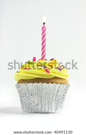 cupcake shot on a white background with one candle