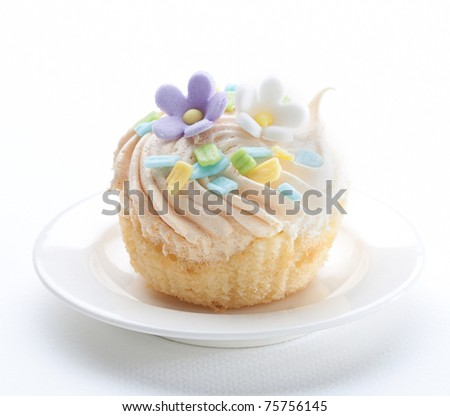 Cupcake topping by icing flowers the image isolated on white