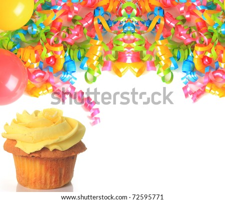 Cupcake with birthday ribbons and balloons.