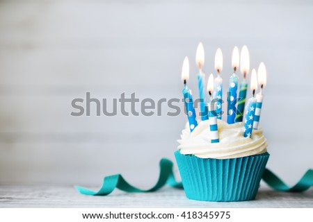 Cupcake with blue birthday candles