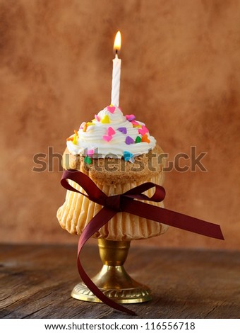 cupcake with candle and cream for birthday