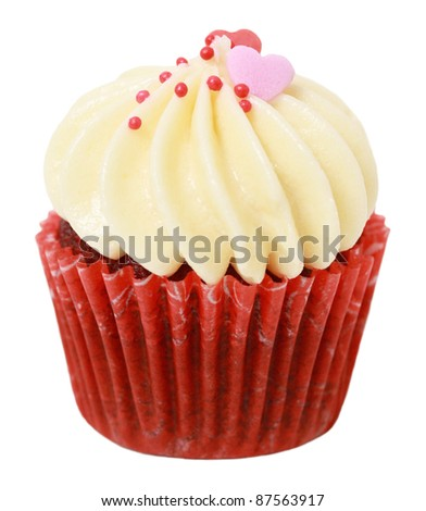 cupcake with heart shape decoration on top