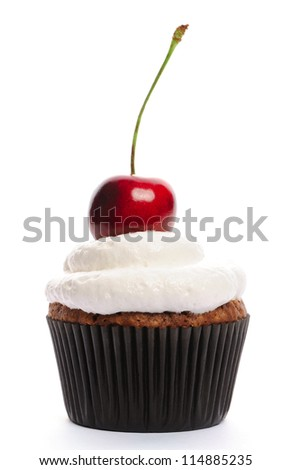 Cupcake with whipped cream and cherry isolated on white - stock photo