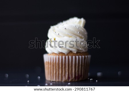 Cupcake with whipped cream black background #290811767