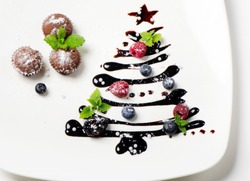 Cupcakes  and sweet  christmas tree with berries and mint
