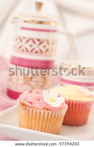 Cupcakes isolated against light background