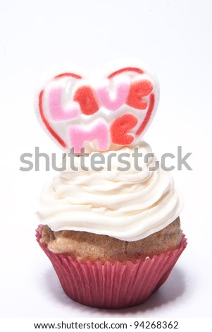 Cupcakes with a Love Me valentine on top