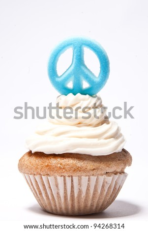 Cupcakes with a peace sign on top