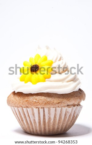 Cupcakes with a yellow flower on top - stock photo