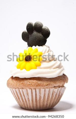Cupcakes with Paw print of a dog and flower on top