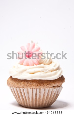 Cupcakes with purple flower on the side - stock photo