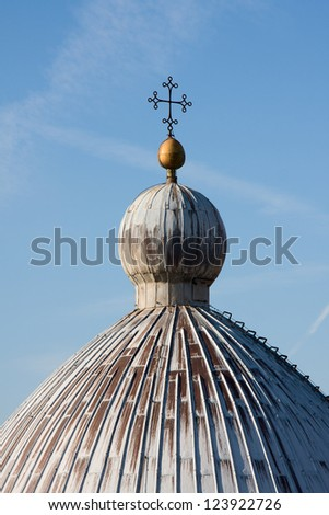 Cupola of Camposanto building with cross on top. Pisa, Italy