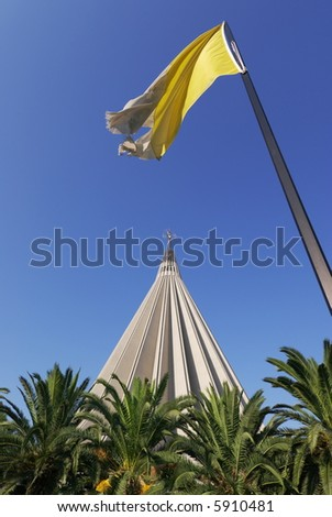 Cupola of the sanctuary of the Madonna of the Tears to Syracuse in Sicily and flag of the Vaticano