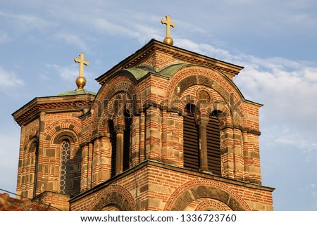 Cupola With Golden Cross Of Ancient Orthodox Church Against Blue Sky