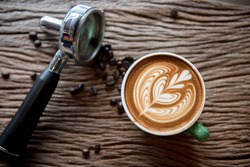 cups of cappuccino with latte art on  wooden background,top view,flat lay