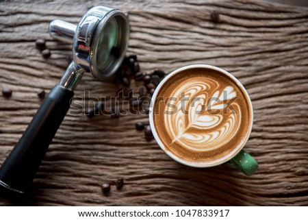 cups of cappuccino with latte art on  wooden background,top view,flat lay #1047833917