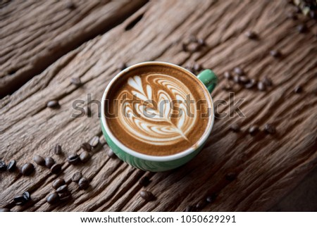 cups of cappuccino with latte art on  wooden background,top view,flat lay #1050629291