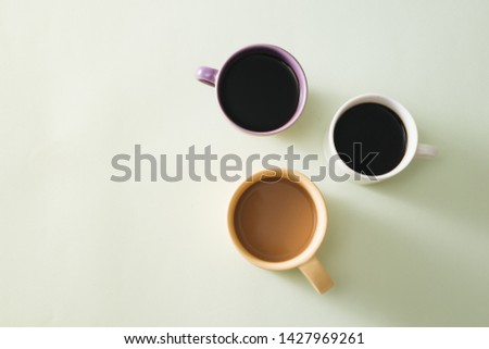 Cups of coffee on light background #1427969261