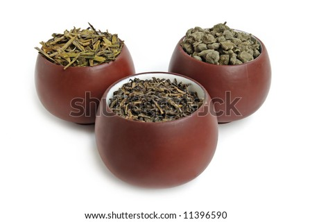 Cups of dried green tea leaves with ginseng