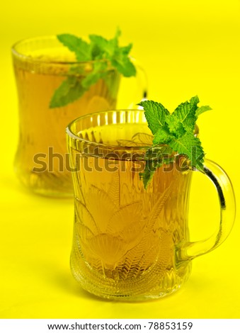 cups of healthy tea with fresh mint