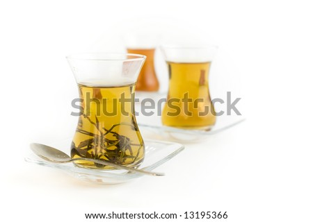 Cups of herbal tea on a white background