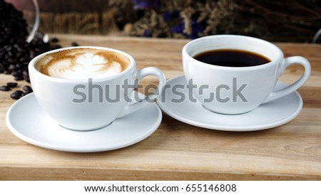 Cups of latte or cappuccino and espresso or americano coffee on a wood table with roasting coffee beans. Aroma and flavor coffee beverage. Morning breakfast with coffee.
