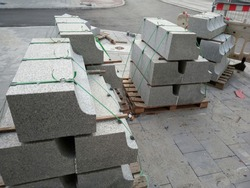 curbs stones are Packed on the road, used to repair the roadway and footpaths. replacement of asphalt in the city, repair, restoration