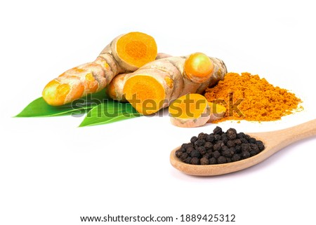 Curcumin powder ( tumeric ground, turmeric, Curcuma ) in wooden bowl and black pepper corn isolated on white background. Stock photo ©