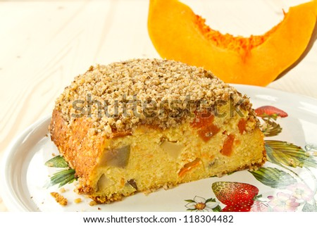 Curd cake with pieces of pumpkin and nuts