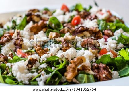 Curd Cheese Salad with Walnut, Arugula Rucola or Rocket Leaves / Cottage Salad. Stok fotoğraf ©