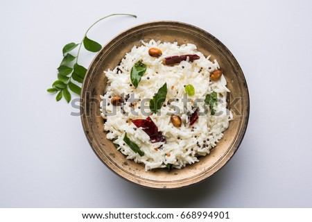 Curd Rice / Dahi Bhat OR Chawal with curry leaf, peanuts and chilli- Served in a bowl over moody background. Selective focus Stok fotoğraf ©