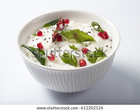 curd rice garnished with pomegranate served in a white bowl on white background Stok fotoğraf ©