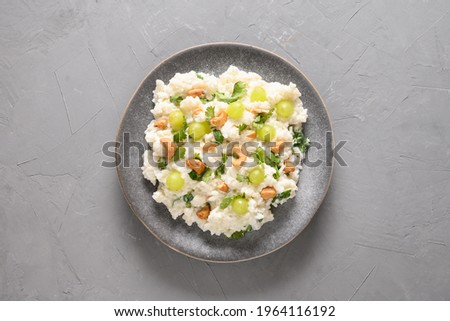 Curd Rice with cashews, grapes, cilantro on a grey background. Top view. Indian South cuisine Stok fotoğraf ©