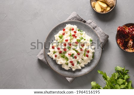 Curd Rice with cashews, grapes, cilantro on a grey background. Top view. Traditional Indian South cuisine Stok fotoğraf ©