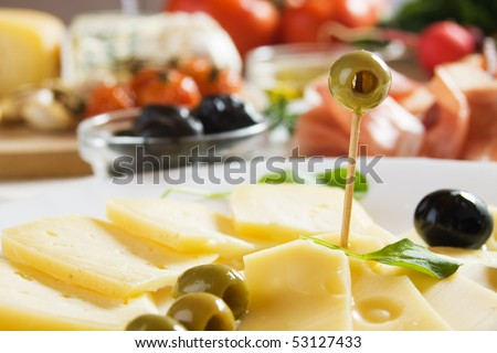 Cured cheese served with olives, traditional italian appetizer