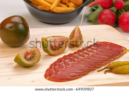 Cured pork loin served with assorted garnish, Spanish speciality - stock photo