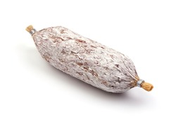 Cured salami with fennel seeds, Italian traditional sausage, isolated on white background.