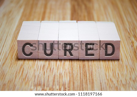 Cured Word In Wooden Cube