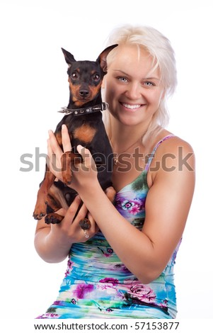Curios miniature dog and happy owner