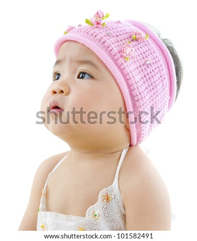 Curious Asian baby girl looking at blank side