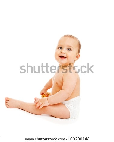 Curious baby boy in diaper holding a bun, isolated