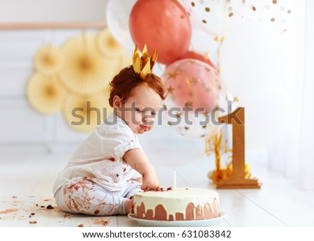 curious baby boy poking finger in his first birthday cake ストックフォト ©