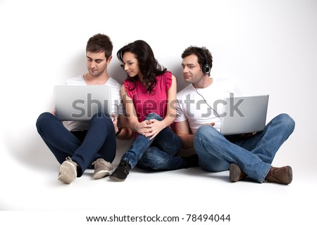 curious friends looking at laptop