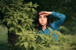 Curious Jealous Woman Spying from Bushes. Funny undercover girl stalking outdoors in surveillance mode
