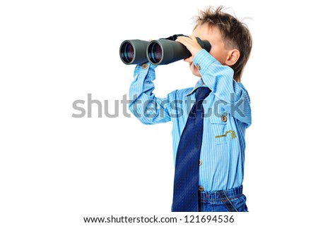 Curious little boy is looking through binoculars. Isolated over white background.