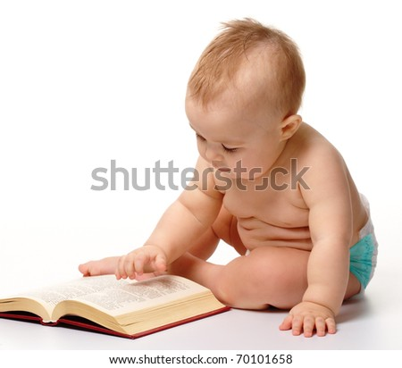 Curious little child play with book while sitting on floor, isolated over white