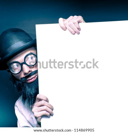 Curious Looking Old Nerd Holding Blank Copyspace Billboard On Black Background
